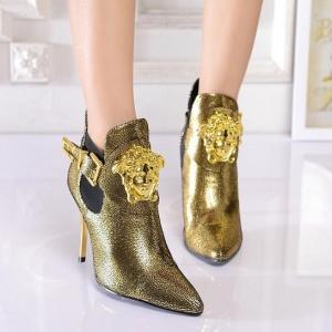 Bota  dourada Versace